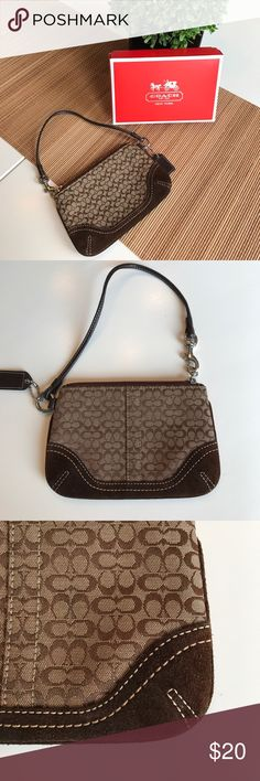 Coach signature brown wristlet with suede bottom Gently used coach wristlet signature small C's.  Dark brown suede on the bottom. Convenient leather strap with a soft suede bottom that adds rich texture to it. Comes with Coach box. Coach Bags Clutches & Wristlets