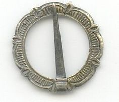 Silver Annular Brooch, C13-14 found Yorkshire. Cast silver; The cross-section of the ring between two of the 'petals' is reduced to locate the sheet-metal pin, which survives complete. Traces of gilt are present on some of the surfaces. 17mm.