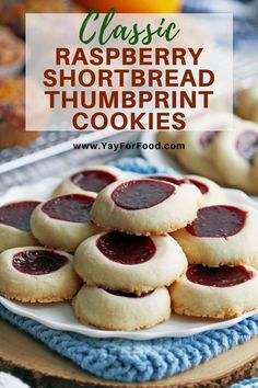 Classic buttery shortbread is filled with sweet and tart raspberry jam in this quick and easy thumbprint cookie recipe. Made with simple ingredients, these delicious cookies are great for sharing… Fun Holiday Desserts, Köstliche Desserts, Holiday Baking, Christmas Baking, Delicious Desserts, Christmas Sweets, Christmas Recipes, Christmas Cookies, Sweets Recipes