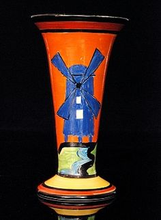 Clarice CLIFF - Applique Windmill - A shape 280 vase circa 1930 hand painted with a stylised landscape with large blue windmill with black and red banding, printed APPLIQUE and Bizarre mark, height 15.5cm. (hva)