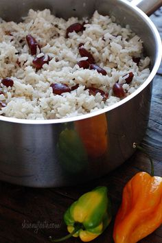 Jamaican Beans and Rice    Ingredients:    1 tsp coconut oil (or canola)  1 garlic clove, crushed  1/4 cup onion, minced  1 scallion, chopped  1 sprig fresh thyme  15.5 oz can red kidney beans, rinsed and drained  2 cups uncooked long grain rice  salt and fresh ground pepper, to taste  2 1/4 cups water  13.5 oz can (1 3/4 cups) light coconut milk  1 whole scotch bonnet hot pepper (not chopped)