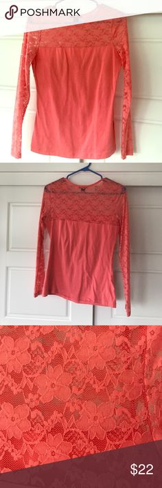 Coral sheer lace sleeved top. Coral long sleeve top with sheer lace chest, upper back and sleeves. Very stretchy material. I got to wear this once and then had a baby. :) excellent condition H&M Tops Tees - Long Sleeve