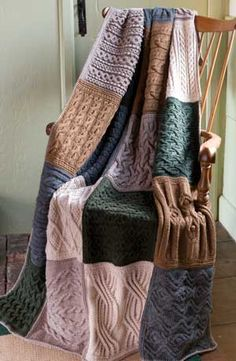 I like the idea of this multi-textured afghan made of different cable patterned…