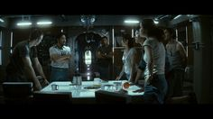 """A highly aesthetic group shot from """"Sunshine"""" (2007), giving the characters strong rim lights, a soft key and eye light from the table, and a few practical tubes in the frame - a composition to remember."""