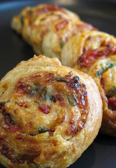 Sun-dried tomato, parmesan &  basil whirls   1 packet puff pastry, 500g, all butter  2-3 cups of grated fresh Parmesan cheese  1 cup sun-dried tomatoes, drained from olive oil and chopped  Fresh basil leaves, torn up  Chilli flakes to taste  1 egg, beaten, for glazing