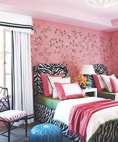 pink chinoiserie wallpaper, zebra print headboards an d bed skirt.  Pink and contrasting olive green tie in with the wallpaper.  Love a graphic black and white drapery too.