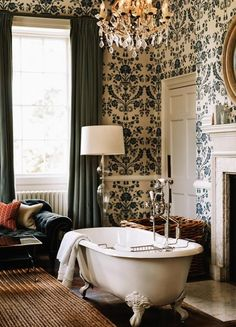 Clawfoot tub, floral wallpaper and antique chandeliers in a blue and white bathroom at Babington House hotel in Somerset, England Best hotels for family holidays in Britain UK breaks (Condé Nast Traveller) House, Interior, Babington House, House Interior, Bathroom Interior, Bathroom Design Luxury, Luxury Bathroom, Bathroom Decor, Beautiful Bathrooms
