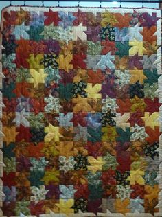 Tesselated Leaf Quilt This is a quilt I made with fabrics I bought while travelling through the Rocky Mountains in Fall. It is a memory quilt of my trip.
