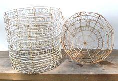 shabby chic white wire baskets.
