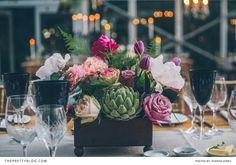 Beautiful bold flower arrangements on each table | Florist: Fleur le Cordeur
