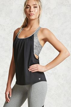 An athletic, mesh twofer tank top featuring a built-in sports bra with a marled pattern, caged back, scoop neck, draped back design, and moisture management.