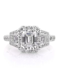 This very rare and beautiful emerald cut diamond engagement ring will leave you breathless! It all starts with the extraordinary 2.00ct emerald cut diamond set in the center. It is GIA certified at F-IF.  It features a halo of round diamonds set around it with two step cut trapezoid diamonds flanked on its sides with diamonds set around them as well. The shank is pave set with round diamonds about half way down.