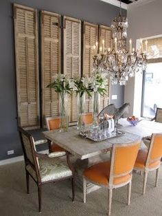 Corey-- something for your dining room? reclaimed shutters used as dining wall decor - beautiful -or- new shutters to give the room the feeling of having a big window on a big blank wall. Style At Home, Old Window Shutters, Vintage Shutters, Repurposed Shutters, Distressed Shutters, Bedroom Shutters, Rustic Shutters, House Shutters, Interior Shutters