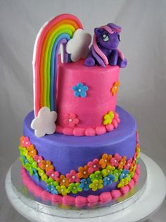 My Little Pony Birthday Cake.  The cake was a hit at Sophia's 6th birthday party.  When doing the rainbow, roll out your different colored fondant and connect them using a little water cut off the excess.