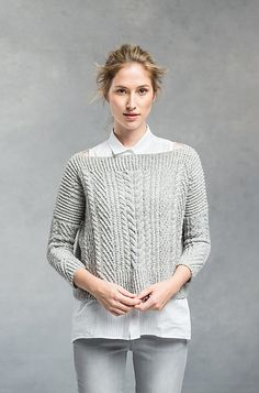 Architectural and completely modern in shape, this cropped pullover is a compelling knit and an eye-catching addition to any wardrobe. The front, back, and sleeves are simple quadrangles worked flat and seamed to achieve a wide, swingy shape with an open neckline and snugly fitted three-quarter-length sleeves. The interplay of twisted ribs, cables, and traveling stitches yields a fabric that wants to move and fold, and clever placement of each element creates flattering lines on the body.