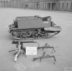 THE BRITISH ARMY IN THE UNITED KINGDOM 1939-45. Universal carrier with Bren guns and Vickers machine-gun displayed, presented by the Chiefs and Peoples of Ishan, Benin in Nigeria, 31 March 1944. Creator: Tanner (Lt), War Office official photographer. Source: © IWM (H 37157) Army Vehicles, Armored Vehicles, British Army, British Tanks, British Armed Forces, Volkswagen, Soviet Army, Ww2 Photos, Armored Fighting Vehicle