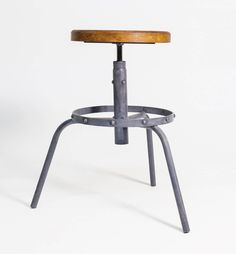 This furniture's industrial style is defined by its solid rivets as well as hand-tarnished and aged steel structure. Trapezoid spindle seat adjustment allows you to adjust the height of industrial bar stools.