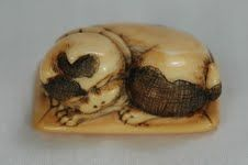 Wood Netsuke of Skull. Superbwood Netsukein the form of a skull. The details in the teeth, and the inside are very detailed. Height 30mm - 45mm Wide. Code W303 SOLD Ivory Netsuke with a boy holdi...