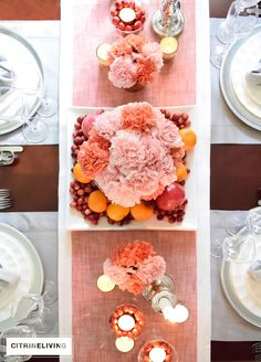 CITRINELIVING - A THANKSGIVING TABLESCAPE Use seasonal fruit and fresh flowers in warm, rich colors combined with cool metals, crisp dishware and blue and white for an unexpected holiday tablescape.