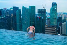 The Infinity Pool at The Marina Bay Sands, Singapore. Officially, the world's tallest infinity pool and an amazing way to not only relax in Singapore but to also take in an amazing view of the city! Visit Singapore, Singapore Travel, Sands Singapore, Quick Travel, Ways To Travel, Travel Hacks, Bali, Sun Goes Down, Amazing Swimming Pools