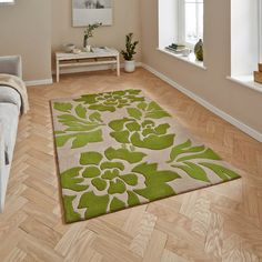 The Hong Kong rug in Beige and Green is handmade in China and offers a luxurious, deep, soft 100% Acrylic pile.