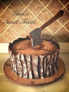 This is my first time uploading a photo to Cakes Decor!! I wanted to share the final results for a groom's cake I was hired to make. They wanted a tree stump with an axe in the top. I watched Liz Marek's Lumberjack Cake Tutorial for inspiration. I...