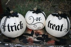 Stack plastic pumpkins 3 high for awesome porch decoration, love the black and white!)