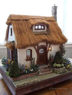 This was the first miniature house I built afterbeing inspired bythe work of Rik Pierce . The design is mostly his, but I had to figure out how to accomplish it on my own, without any plans. I...