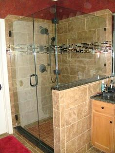 Master bathroom remodel- Behind the Design This is the kind of small glass tiles I want in the shower.