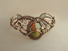 Copper wrapped wire bracelet. Artist not identified, unfortunately.