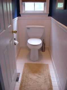 Adding beadboard wallpaper with chairrail in a bathroom to create architectural details.  Add molding and you're done!