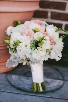 Rhode Island-based florist Toni Chandler crafted this pretty wedding bouquet of pink peonies mixed with white zinnias and dusty miller for a seaside Newport wedding....