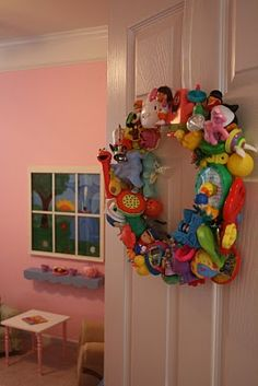 Put those small unused toys to good use...make a wreath for the playroom