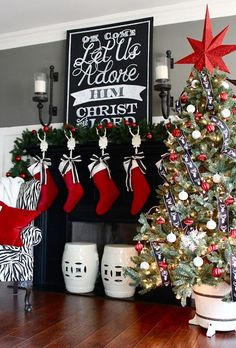 White Stocking Holders and White Garden Stools Help To Keep the Black Fireplace From Looking Too D ark. - 2015 Holiday House Tour