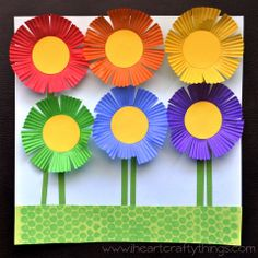 """Cupcake Liner Flower Garden Craft to go along with book """"Planting a Rainbow"""" by Lois Ehlert. Crafts Planting a Rainbow Flower Craft Cupcake Liner Crafts, Cupcake Liner Flowers, Cupcake Liners, Cupcake Cases, Spring Crafts For Kids, Summer Crafts, Art For Kids, Art Children, Children Crafts"""