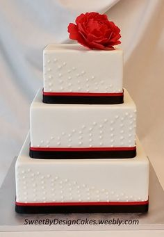 """Red and Black Wedding Cake with Peony - 6, 8, and 10"""" square cakes covered in fondant with buttercream dot pattern and red and black ribbon. Topped with a fondant peony."""