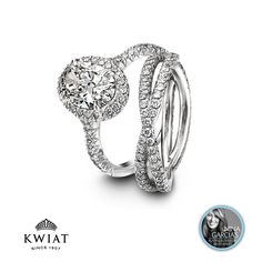 Kwiat oval cut platinum engagement ring and platinum wedding band for her.