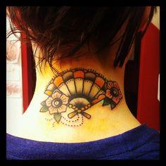 a dainty little fan with flowers tattoo