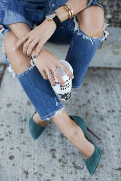 Pair ripped blue denim with a dainty black watch and suede teal sandals for the perfect coffee date outfit combo.