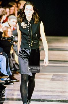 Model walks the Helmut Lang Fall 1989 RTW collection.