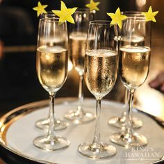 Hosting a viewing party for Awards Season? Sliced starfruit glams up champagne or sparkling cider. VIP's get their glass at the door.