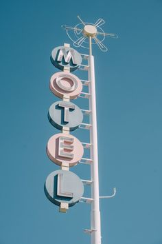 Motel blue sign under blue summer sky. Vintage style and photography with neon typography. USA and american life. Motel or hotel ? Shop this poster, art print or frame for your wall in your home decoration by Light Blue Aesthetic, Blue Aesthetic Pastel, Aesthetic Pastel Wallpaper, Aesthetic Colors, Aesthetic Collage, Aesthetic Vintage, Aesthetic Pictures, Aesthetic Wallpapers, Aesthetic Girl