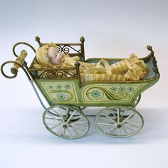 Antique Marklin tin doll carriage with all original bisque baby doll