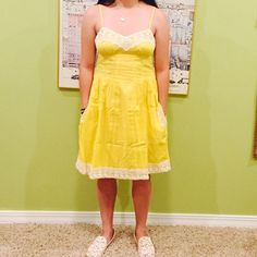 Yellow summer dress bought from Urban Outfitters. Kimchi Blue, 100% cotton, ivory crochet trim, side pockets key hole button opening in back, never worn. Considering all offers EXCEPT trades. Kimchi Blue Dresses