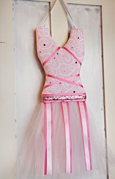 Pink Baby Boutique - Luxe light pink swirl ballerina tutu bow holder, $36.00 (http://www.pinkbabyboutique.com/luxe-light-pink-swirl-ballerina-tutu-bow-holder/)