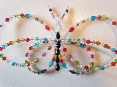 Create your own sparkling garden sun catcher from crystals.