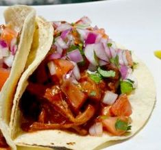 """BBQ Pork Tacos: """"These delicious tacos are the perfect choice to prepare a quick dinner. I made them with pork loin in barbecue sauce and a pico de gallo-style salad. You will not be able to eat just one."""" - Basic and Delicious"""