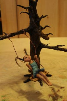 Silly paper clay sculpture tree and girl on swing: Adrena Roude