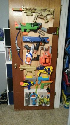 Mark and I made Jacob a cool nerf gun storage. The Effective Pictures We Offer You Abo Nerf Gun Storage, Diy Toy Storage, Nerf Birthday Party, Nerf Party, Cool Nerf Guns, Star Wars Room, Toy Rooms, Toy Organization, Playroom