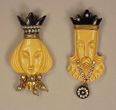 Two Bakelite Heraldic Brooches Depicting a king and queen, each set with faux pearls and rhinestones. Heights 2 7/8 inches.  Sold for $40...